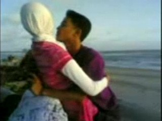 indonesian hijabi girl at the seaside with lover